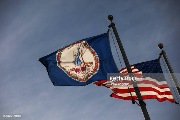 The Virginia State flag and the American flag fly near the Virginia State Capitol, February 9, 2019 in Richmond, Virginia. Virginia state politics...