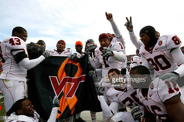 The Virginia Tech Hokies celebrate in the final minutes of the second half as they defeat the Virginia Cavaliers 33-21 at Scott Stadium on November...