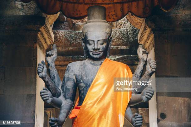 The Vishnu God statue in Angkor Wat the largest religion place in the world, Siem Reap of Cambodia.