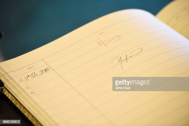 The visitors book bares the signatures of Prince Harry Duke of Sussex and Meghan Duchess of Sussex following their meeting with Ireland's President...