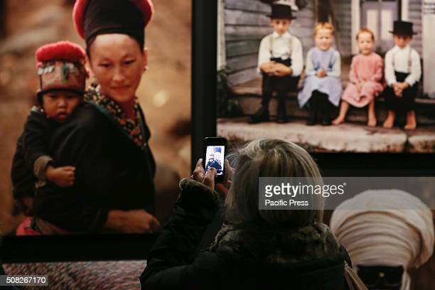 The visitors examining a photo during the 'Fashion' exhibit From 4 February to 2 May 2016 Palazzo Madama hosts the photo exhibition called 'Fashion...