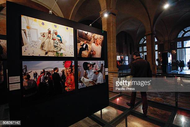 The visitors examining the photo during the 'Fashion' exhibit From 4 February to 2 May 2016 Palazzo Madama hosts the photo exhibition called 'Fashion...