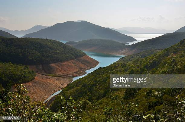 The vista of High Island Reservoir and the South China Sea, from stage two of the MacLehose Trail, in Sai Kung, Hong Kong.