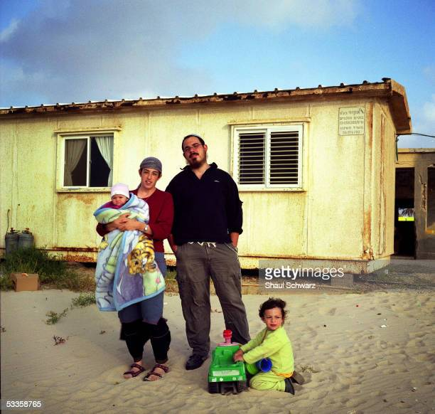 USA*** The Vitcon family the mother Rachel holding baby girl Sharodechya father AviNadav and Mevaser stands for a portrait in front of their house...