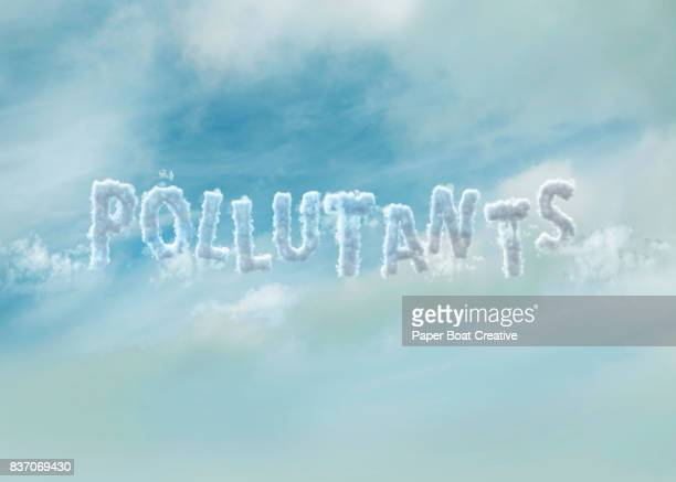 the vocable pollutants outlined in clouds, showed in a way as if its up in the sky with a blue hazy background - typographies stock photos and pictures