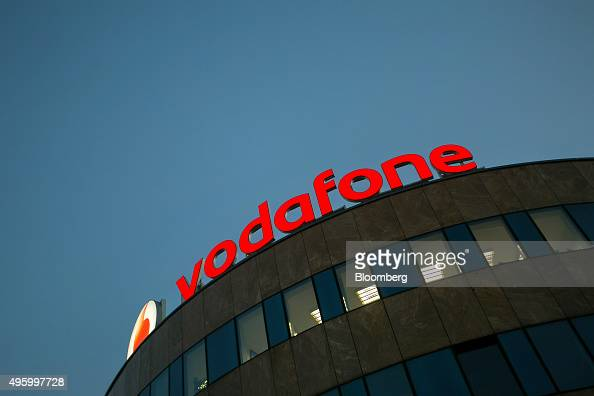 The Vodafone logo sits illuminated on top of the Vodafone ...