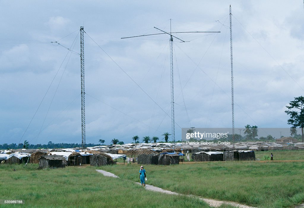 The Voice of America Refugee Camp in Liberia is named for the Voice of America broadcast antennas standing nearby. Thousands of refugees were displaced to camps or fled to neighboring countries during the Liberian Civil War.   Location: Voice of America Refugee Camp, Liberia.