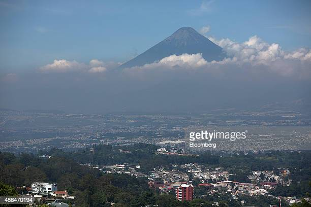 The Volcan de Agua or Water Volcano stands past buildings in Guatemala City Guatemala on Tuesday Sept 1 2015 Guatemala which saw its president resign...