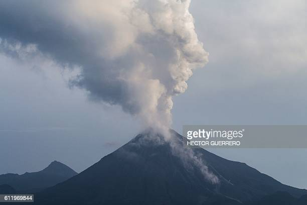 The Volcan de Fuego volcano spews ash and smoke on October 2 2016 as seen from San Antonio Colima State Mexico Mexican authorities have evacuated 400...