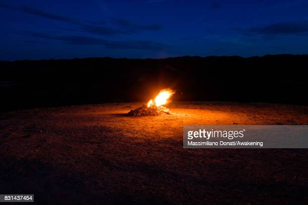 The volcano's flame coming out from the subsoil burns during the night on August 14 2017 in Forli Italy The volcano of Monte Busca is the smallest in...