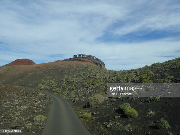 The volcanos route, whit a building by Cesar Manrique architect on the top of the hill. Timanfaya