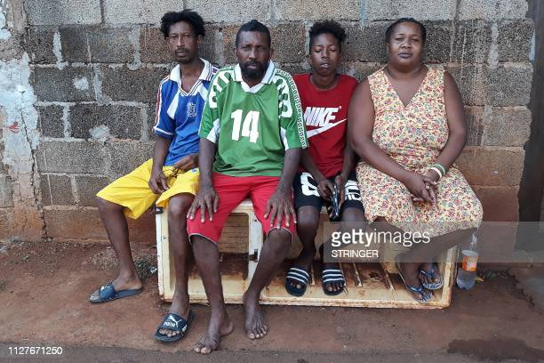 The Voldrin family which is among Chagossian families exiled from the Chagos islands poses for a photo on February 26 2019 in front of their home in...