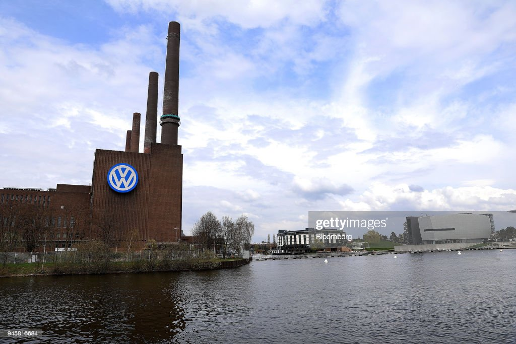The Volkswagen AG (VW) headquarters stands on a bank of the Aller river in Wolfsburg, Germany, on Friday, April 13, 2018. Volkswagen AGs new top manager pledged to speed up the German carmaking giants decision-making as it confronts a seismic industry change in technology while moving beyond its diesel-emissions scandal. Photographer: Krisztian Bocsi/Bloomberg via Getty Images