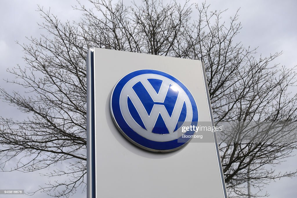 The Volkswagen AG (VW) logo sits on a sign outside the automaker's headquarters in Wolfsburg, Germany, on Friday, April 13, 2018. Volkswagen AGs new top manager pledged to speed up the German carmaking giants decision-making as it confronts a seismic industry change in technology while moving beyond its diesel-emissions scandal. Photographer: Krisztian Bocsi/Bloomberg via Getty Images