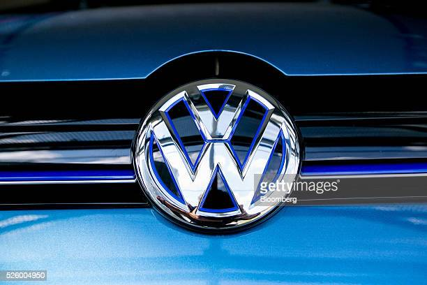 The Volkswagen badge sits on an eGolf electric automobile produced by Volkswagen AG as it stands inside one of the automaker's glass delivery towers...