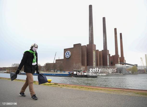 The Volkswagen factory stands on the first day following a temporary halt to car production there on March 20 2020 in Wolfsburg Germany Automakers...