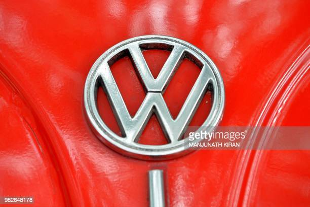 The Volkswagen logo is seen on the bonnet of vintage Beetle car during a rally held as part of the 23rd anniversary of World Wide VW Beetle Day in...