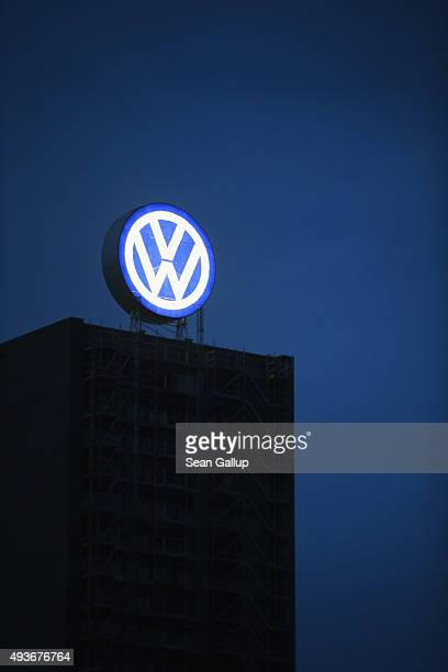 The Volkswagen logo stands illuminated on an administrative building at the Volkswagen factory and company headquarters on October 21 2015 in...