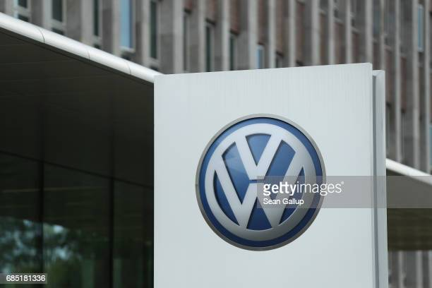 The Volkswagen logo stands outside the main administrative building of the Volkswagen brand at the Volkswagen car factory on May 19, 2017 in...