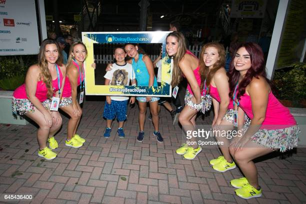 The Volley Girls pose with fans at the ATP Delray Beach Open on February 25 at the Delray Beach Stadium Tennis Center in Delray Beach Florida