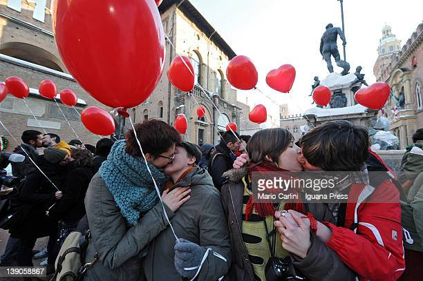 The volounteers of the next Gay Pride celebrate Valentine's day with a collective kiss at the Nettuno square on February 14 2012 in Bologna Italy