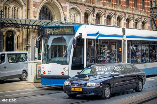 The Volvo S80 royal car of Princess Beatrix of The Netherlands passes a tram before her arrival the Royal Palace for the annual palace symposium on...