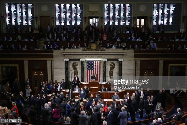 The vote count is projected on the walls of the House of Representatives as Speaker of the House Nancy Pelosi presides over voting on the second...