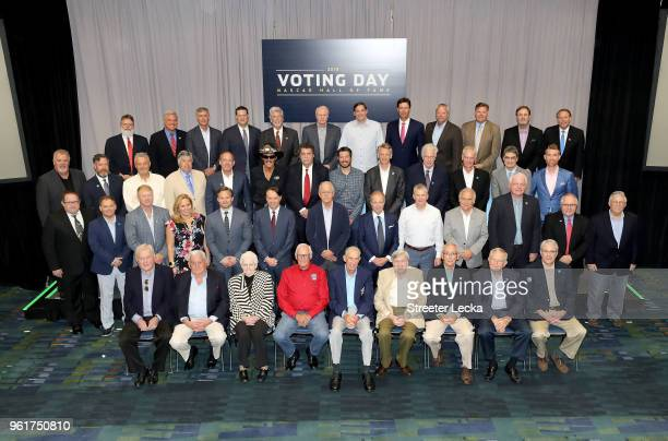 The voting panel poses for a photograph before the NACAR Hall of Fame Voting Day at NASCAR Hall of Fame on May 23 2018 in Charlotte North Carolina