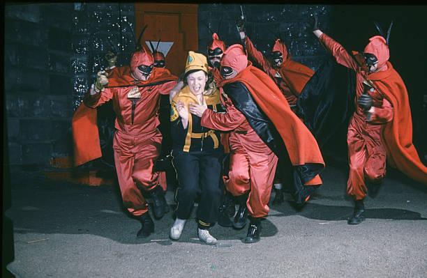 The Vulcan Krewe grabs a women during the StPaul Winter Carnival in StPaulMinnesota