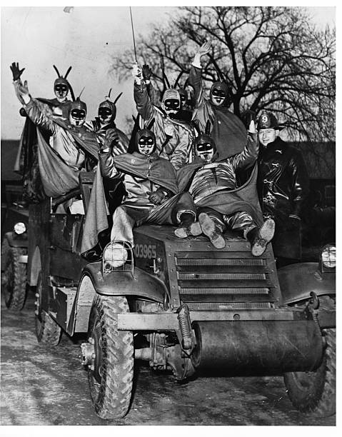The 'Vulcans' commandeer an armored car on their way to overthrow King Boreas their traditional function at the end of the St Paul Winter Carnival