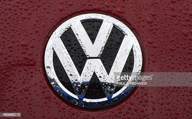 The VW emblem is seen on a new Volkswagen for sale October 1 2015 at a dealership in Gaithersburg Maryland AFP PHOTO/PAUL J RICHARDS / AFP / PAUL J...