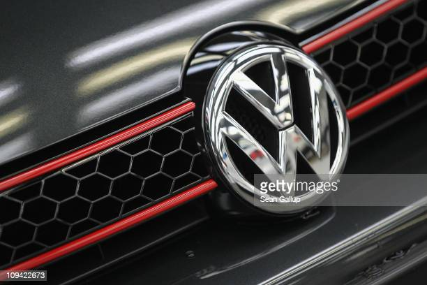 The VW logo shines as the hood ornament on a new Volkswagen Golf 6 car at the Volkswagen factory on February 25, 2011 in Wolfsburg, Germany....