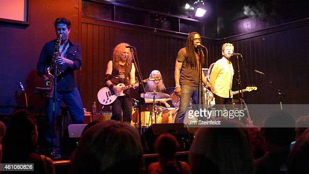The Waddy Wachtel band Ron Dziubla Al Ortiz Waddy Wachtel Phil Jones Bernard Fowler and Blondie Chaplin perform at the Black Rose Tavern in Los...