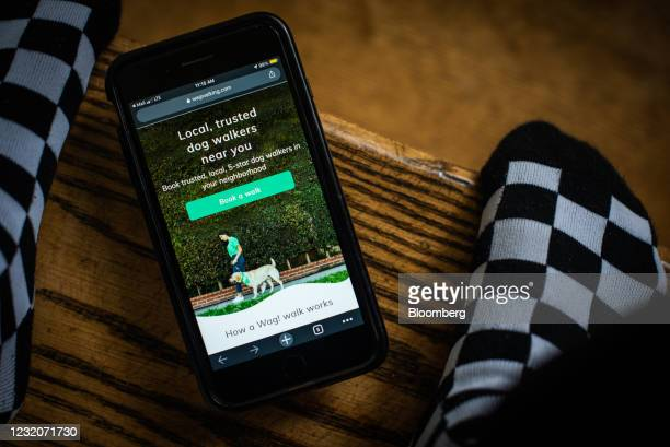 The Wag Labs Inc. Website on a smartphone arranged in Dobbs Ferry, New York, U.S., Thursday, April 1, 2021. One of the signs that Covid-19's hold...