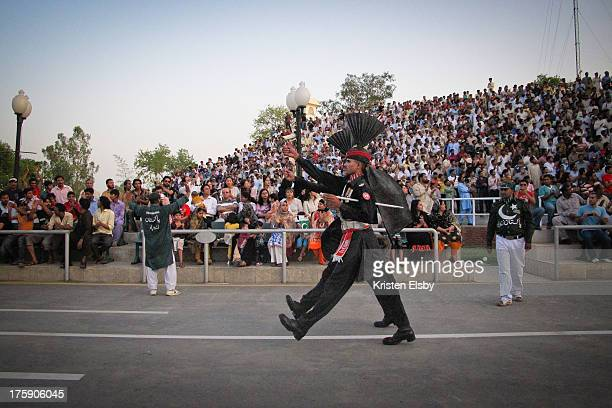 CONTENT] The Wagah border closing ceremony and lowering of the flags is a daily military ceremony that the security forces of India and Pakistan have...