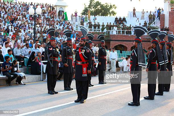 The Wagah border closing 'lowering of the flags' ceremony is a daily military practice that the security forces of India and Pakistan have jointly...