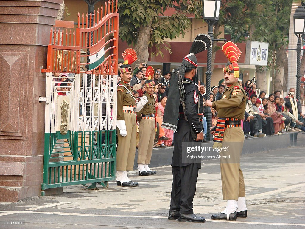 CONTENT] The Wagah border closing `lowering of the flags` ceremony or The Beating Retreat ceremony is a daily military practice that the security...