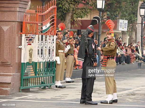 CONTENT] The Wagah border closing 'lowering of the flags' ceremony or The Beating Retreat ceremony is a daily military practice that the security...