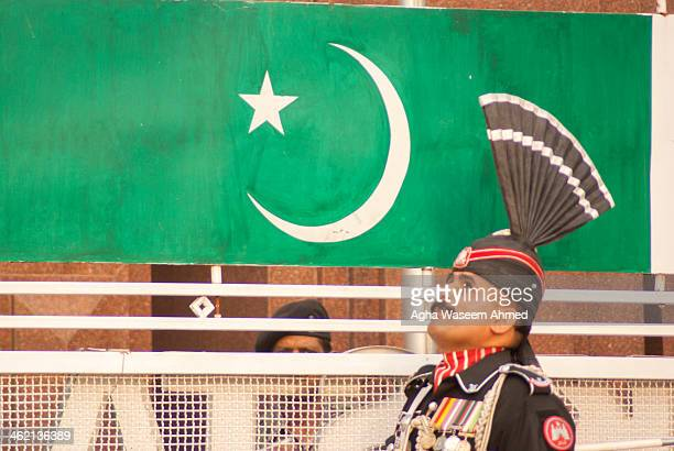 The Wagah border closing 'lowering of the flags' ceremony or The Beating Retreat ceremony is a daily military practice that the security forces of...