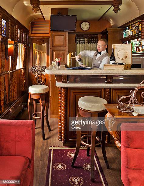 the waiter in the luxury trans siberian express train - aquila reale foto e immagini stock