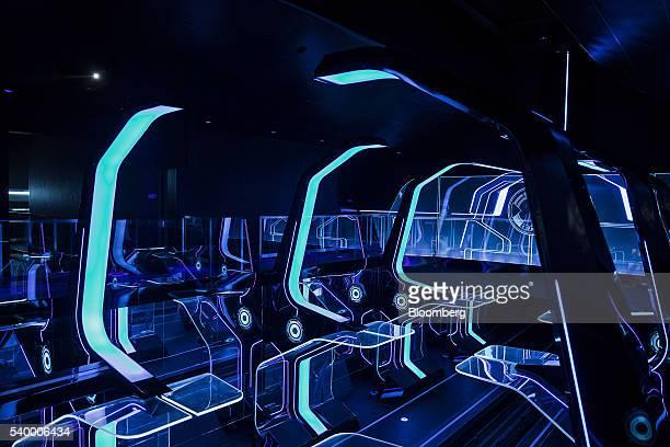 The waiting area for the Tron Lightcyle Power Run rollercoaster is illuminated at Walt Disney Co's Shanghai Disneyland theme park during a trial run...
