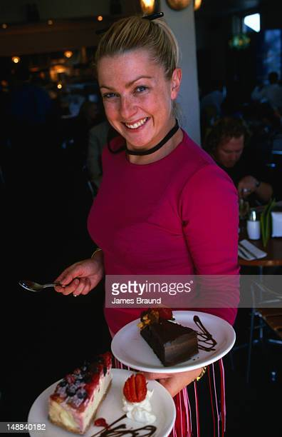 The waitress with the cakes from the London Hotel cafe in Port Melbourne.