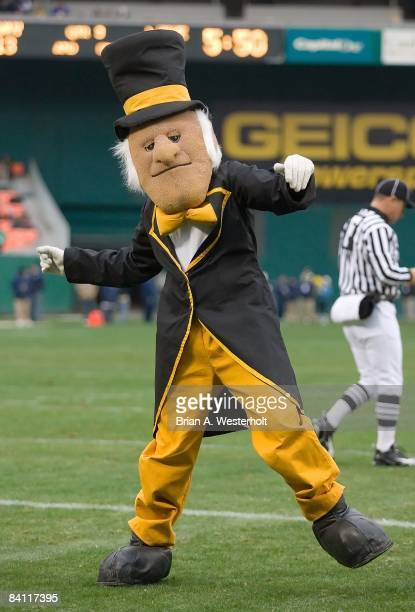 The Wake Forest Demon Deacon mascot tries to get the fans fired up during a time out versus the Navy Midshipmen in the EagleBank Bowl at RFK Stadium...