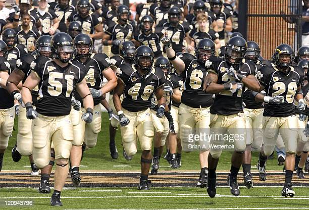 The Wake Forest Demon Deacons run on to the field prior to taking on the Duke Blue Devils at Groves Stadium in WinstonSalem NC Saturday September 9...