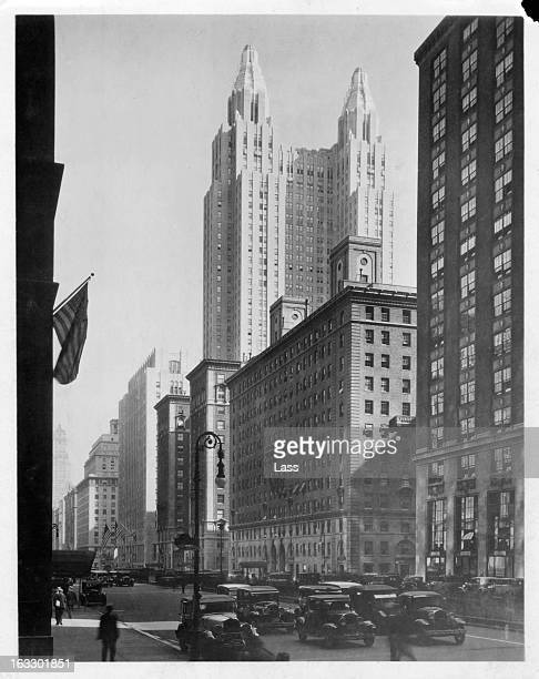 The Waldorf Astoria Towers in the distance over the other buildings on Park Avenue in New York City, 1930s.