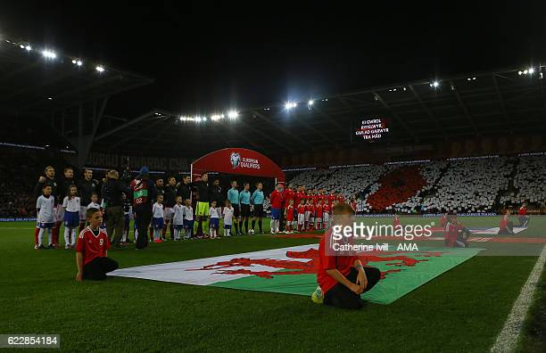 The Wales fans display a poppy mosaic as the teams line up before the FIFA 2018 World Cup Qualifier between Wales and Serbia at Cardiff City Stadium...