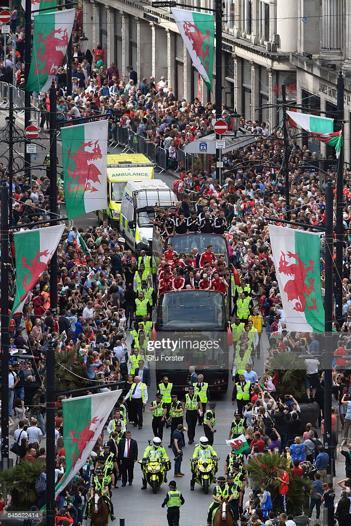 The Wales Football squad head down St Mary's street on their bus parade around Cardiff on their EURO 2016 homecoming tour on July 8, 2016 in Cardiff, Wales.