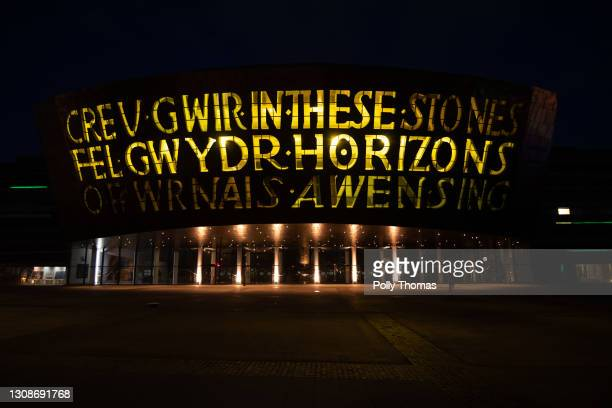 The Wales Millennium Centre lit up yellow during a National Day of Reflection on March 23, 2021 in Cardiff, United Kingdom. Marie Curie Cancer...