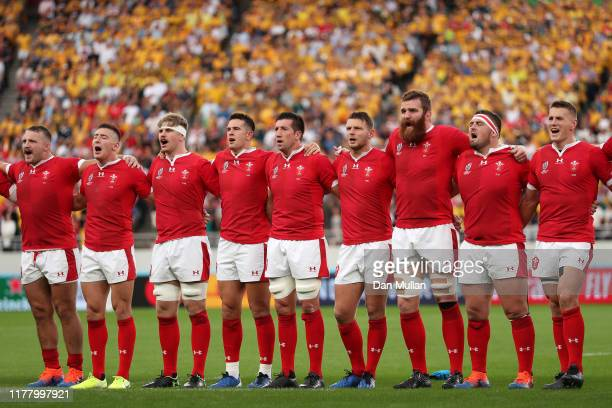 The Wales players line up to sing the national anthem during the Rugby World Cup 2019 Group D game between Australia and Wales at Tokyo Stadium on...