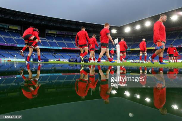 The Wales players make their way onto the pitch during the Wales Captain's run ahead of their 2019 Rugby World Cup SemiFinal match against South...